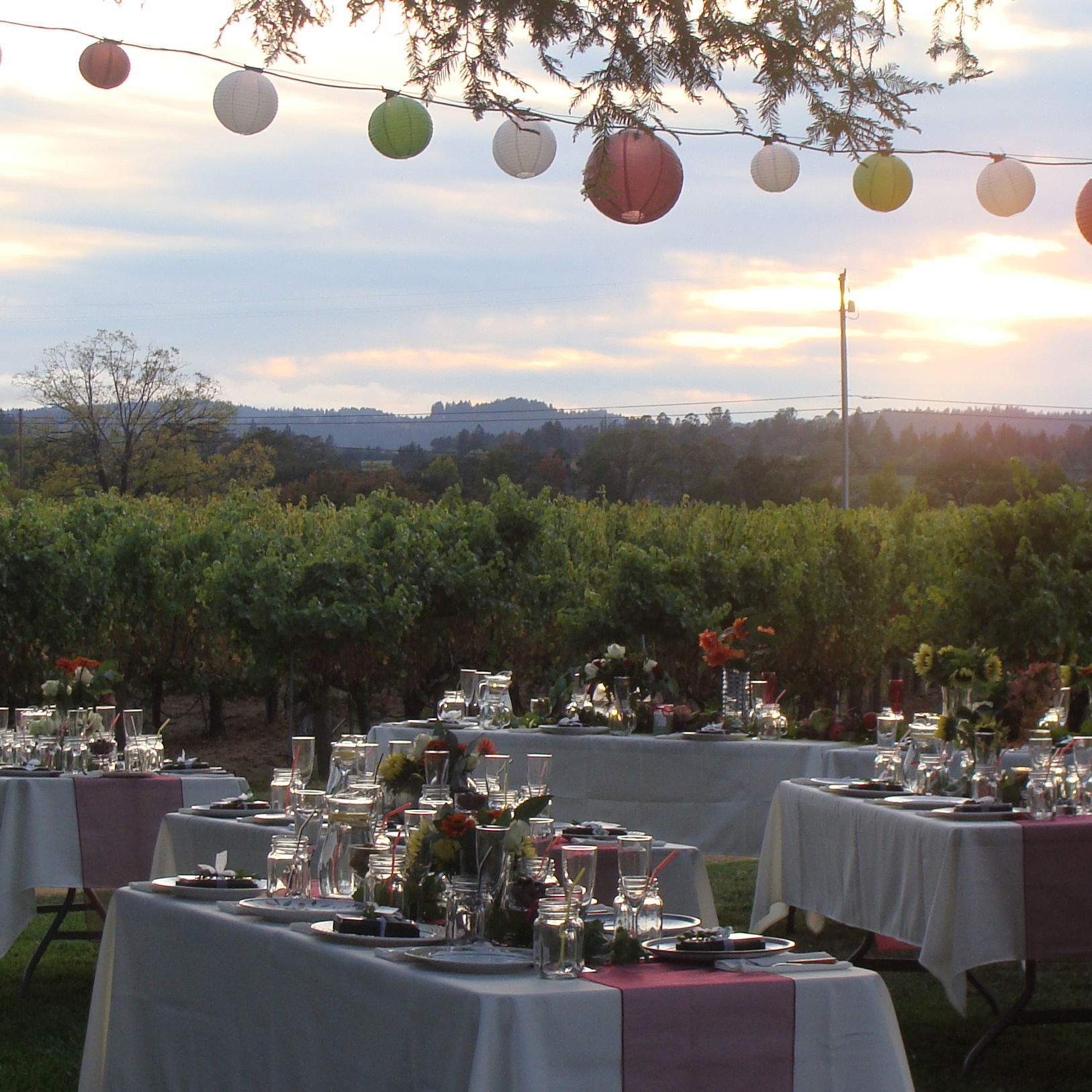 table settings before an outdoor summer evening event at Hook & Ladder Vineyards & Winery